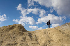 Hiking. Young male photographer walking at the muddy volcanoes in Romania stock images