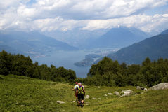 Hiking. Three men hiking in a mountain above the Como lake - Italy royalty free stock images