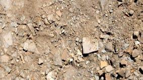 Hiking across cracked desert landscape stock video