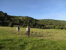 Hiking across field Royalty Free Stock Photos