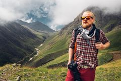 Hiking Adventure Blogger Travel Concept. Handsome Male Traveler stock photo