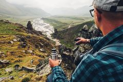 Hiking Adventure Tourism Concept. Young Traveler Man Holding The stock photography