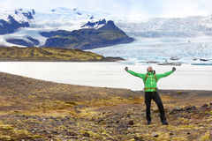 Hiking adventure travel man cheering happy Iceland royalty free stock images