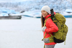Hiking adventure trekking woman by glacier Iceland. Hiking adventure trekking woman by glacier on Iceland. Hiker trekking walking by glacial lagoon / lake of Stock Image