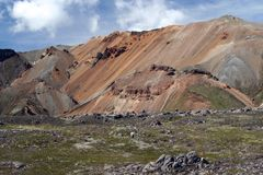 Hiking along a bizarr sharp colorful rock formation at Landmannalaugar, Iceland stock photos