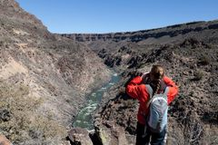 Young woman looking at Rio Grande river from viewing point royalty free stock photos