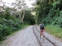 Hiking along the train tracks of Peru Rail on the road to Aguas royalty free stock photo