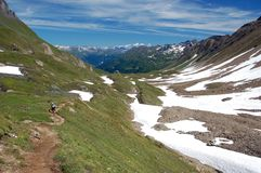 Hiking in the Alps. Hiking along trail in the Alps stock photo