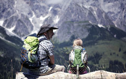 Hiking in the Alps. Father and Daughter resting during hiking trip in the european Alps Royalty Free Stock Photography