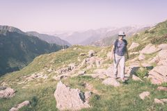 Hiking in the Alps on footpath, toned image Royalty Free Stock Photos
