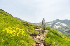 Hiking in the Alps on panoramic footpath Royalty Free Stock Images