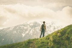 Hiking in the Alps on panoramic footpath, toned image Royalty Free Stock Photos