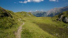 Hiking the alps in summer royalty free stock photography