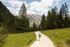 Hiking in Alps stock photo