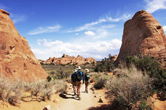 Hiking in Arches National Park. The spectacular petrified sandstone formations attract hikers to Arches National Park in southern Utah's red rock country Stock Photo