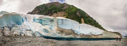 Hiking around Davidson Glacier ice pack. Alaska on a cloudy summers day stock image
