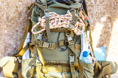 Hiking backpack camping equipment outdoor on grunge wall Stock Photography