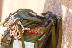 Hiking backpack camping equipment outdoor on grunge wall Royalty Free Stock Image