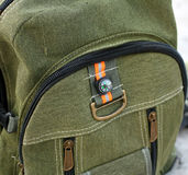 Hiking backpack color khaki with a compass behind. Hiking backpack color khaki with a compass behind Stock Photo