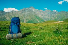 Hiking backpack with foam against the background of the Caucasus. Hiking backpack with foambackground of the Caucasus mountains sunny weather Stock Photo