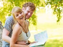 Hiking backpacking couple reading map on trip. Royalty Free Stock Photos