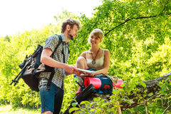 Hiking backpacking couple reading map on trip. Royalty Free Stock Image