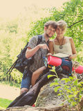 Hiking backpacking couple reading map on trip. Royalty Free Stock Photo