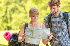 Hiking backpacking couple reading map on trip. Stock Photo