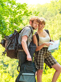 Hiking backpacking couple reading map on trip. Royalty Free Stock Images