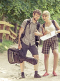 Hiking backpacking couple reading map on trip. Stock Images