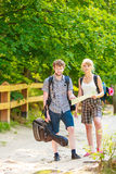 Hiking backpacking couple reading map on trip. Stock Photos