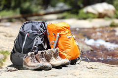 Hiking backpacks and hiker shoes royalty free stock photo