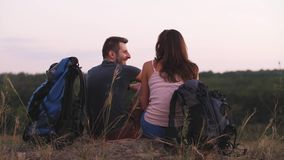Hiking with backpacks. Young man and woman hiking with backpack stock video footage