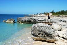 Hiking in Bahamas. The girl exploring eroded coastline on Grand Bahama Island (The Bahamas royalty free stock photos