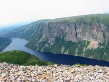 Hiking in beautiful Gros Morne National Park atop Gros Morne Mountain in Newfoundland and Labrador, Canada royalty free stock photo