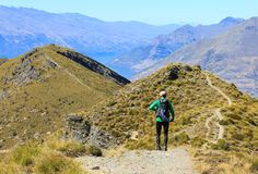 Hiking on Ben Lomond. A mature caucasian hiker with backpack on the slope of Ben Lomond, Queenstown New Zealand Royalty Free Stock Image