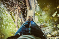 Hiking in blue jeans and boots Stock Image