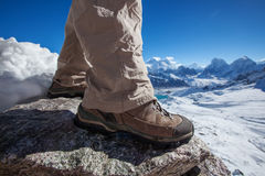 Hiking boot closeup. On mountain rocks Stock Images