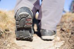 Hiking boot closeup on mountain rocks. Stock Photography
