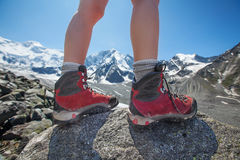 Hiking boot closeup on mountain rocks Stock Photography