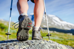 Hiking boot on mountain rocks. Hiking boot closeup on mountain rocks Royalty Free Stock Images