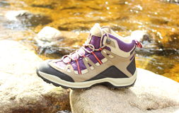 Hiking boot over a mountain stream Royalty Free Stock Photos
