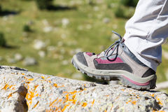 Hiking boot on a rock Royalty Free Stock Photo