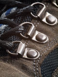 Hiking Boot shoelace eyelet perspective. Brown Hiking Boot with black laces eyelet perspective stock images
