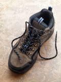 Hiking Boot with shoelace on tile Royalty Free Stock Photo