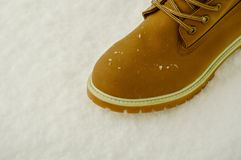 Hiking boot in the snow royalty free stock photos