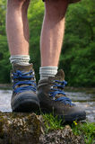 Hiking boots. Standing on a rock stock photography