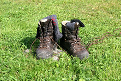 HIKING BOOTS. Wandering boots and socks on a grassland stock photo