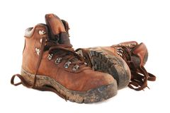Hiking Boots. A pair of muddy brown hiking boots, isolated on white Stock Photo
