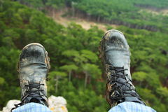 Hiking boots. Looking for hiking boots over the precipice Royalty Free Stock Images